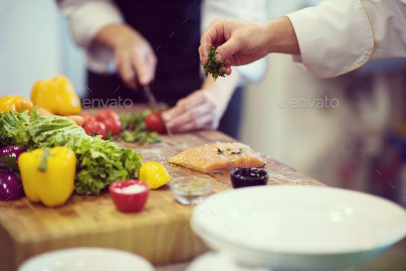 Chef hands preparing marinated Salmon fish - Stock Photo - Images