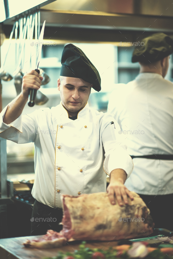 chef cutting big piece of beef - Stock Photo - Images