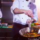 chef putting spices on vegetables in wok - PhotoDune Item for Sale