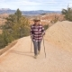Hiker Blonde Mature Woman Climbs A Footpath In The Bryce Canyon, Utah, USA - VideoHive Item for Sale