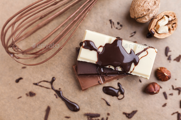 Delicious chocolate bars with melted chocolate - Stock Photo - Images