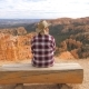 Woman Sits On The Log And Looks View At A Beautiful Panorama Of The Bryce Canyon - VideoHive Item for Sale