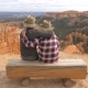 Love Couple Sit On The Log, Looking At A Picturesque View Of The Bryce Canyon - VideoHive Item for Sale