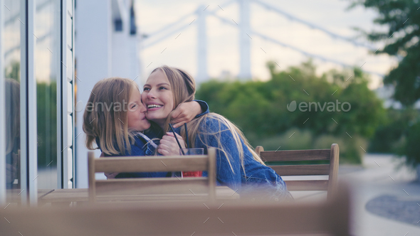 Young hugging mother and daughter - Stock Photo - Images