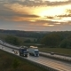 Cars Traveling on the Highway Road at Sunset,