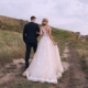 Bride and Groom Walk on the Road Against the Backdrop of Green Hills - VideoHive Item for Sale