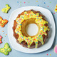 Easter Bundt cake with colorful topping and Easter Cookies - PhotoDune Item for Sale