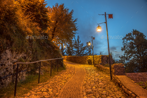 Illuminated cobblestone road - Stock Photo - Images
