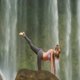 Girl Stands on Knee Hands in Yoga Pose at Water Jets - VideoHive Item for Sale