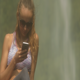 Blonde Lady in Sunglasses Texts Sms by Waterfall - VideoHive Item for Sale