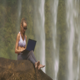 Girl in Violet Top Works with Laptop on Large Rock - VideoHive Item for Sale
