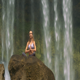 Woman Sits in Lotus Pose on Stone against Water - VideoHive Item for Sale