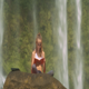 Girl Reads Book against Plants behind Waterfall Jets - VideoHive Item for Sale