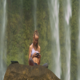 Woman Watches Video on Tablet against Waterfall - VideoHive Item for Sale