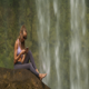 Blond Girl Sits Barefoot on Stone Listens to Music - VideoHive Item for Sale