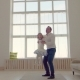 Happy Family Idyll Little Child Daughter Jump On Father Arms - VideoHive Item for Sale