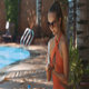 Girl Opens Sunscreen to Smear Body on Sunny Day - VideoHive Item for Sale