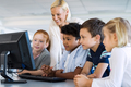 Kids in computer class with teacher - PhotoDune Item for Sale
