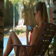 Girl with Ponytail Chats on Phone in Folding Chair - VideoHive Item for Sale