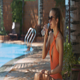 Girl Drinks Water from Bottle on Sunny Day by Pool - VideoHive Item for Sale