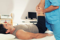 Physiotherapist Working With Patient Leg - PhotoDune Item for Sale