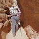 A Hiker Woman Walks Between The Rocks Of The Grand Canyon - VideoHive Item for Sale