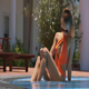 Sexy Woman Sits in Pool Sunbathes under Sunlight - VideoHive Item for Sale