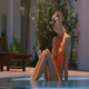 Girl in Bikini Sits in Swimming Pool with Phone - VideoHive Item for Sale