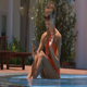 Girl Chats on Phone Sits in Shallow Pool - VideoHive Item for Sale
