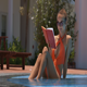 Girl Sits in Swimming Pool Reads Book at Hotel - VideoHive Item for Sale
