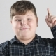 Young Fat Boy Pointing Finger Up and Having an Idea - VideoHive Item for Sale