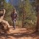A Hiker Woman Walks Between The Red Rocks Of The Canyon And Big Stone - VideoHive Item for Sale