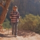 A Hiker Woman Walks On Trekking Footpaths The Red Rocks Of The Zion Canyon - VideoHive Item for Sale
