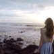 Shapely and Tall Girl Stands on a Rock on the Coast of the Ocean on the Island Bali - VideoHive Item for Sale