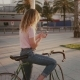 Pretty Girl on Her Urban Vintage Bicycle at Sunset - VideoHive Item for Sale