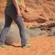 Legs Of A Woman Going In The Sand Of The Red Rock Canyon In Desert Mojave - VideoHive Item for Sale