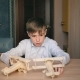 The Boy at Home Collects a Wooden Plane. The Concept of Dream and Childhood - VideoHive Item for Sale
