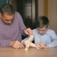 Father and Son Collect a Wooden Model of an Airplane - VideoHive Item for Sale