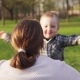 Happy Little Boy Runs into Mother's Open Arms and Hugs Her in Spring Park - VideoHive Item for Sale