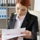 Redhead Businesswoman Signing Some Papers with Charts on Them - VideoHive Item for Sale