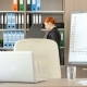 Redhead Businesswoman in the Office Checking Some Folders in the Back - VideoHive Item for Sale
