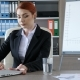 Businesswoman Takes a Seat at Her Desk, Drinks a Glass of Water and Starts Typing on the Laptop - VideoHive Item for Sale