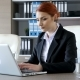 Smiling Redhead Businesswoman Typing on the Laptop - VideoHive Item for Sale