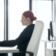Beautiful Redhead Businesswoman at Her Desk in the Office Typing on the Laptop - VideoHive Item for Sale