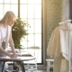 Young Fashion Woman Designer Drawing Design Sketch Working in Her Manufacturing Office Studio - VideoHive Item for Sale