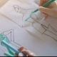 The Hand of the Designer with a Pen, Designing and Sketching - VideoHive Item for Sale
