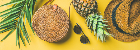 Colorful summer female outfit over yellow background, wide composition - Stock Photo - Images