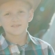 Portrait of Stylish Little Cowboy Stands Near Purebred Horse on Sunlight. Slowly - VideoHive Item for Sale