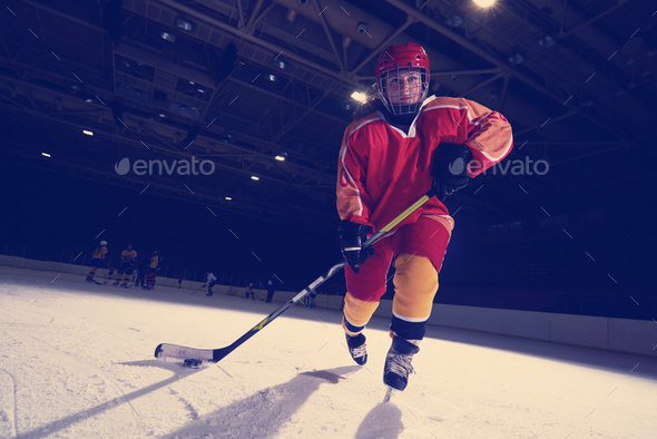 teen ice hockey player in action - Stock Photo - Images