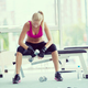 young woman exercise with dumbells - PhotoDune Item for Sale